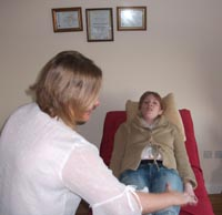Reiki therapist at work with a client