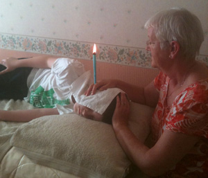 Ear candling therapist wth a client